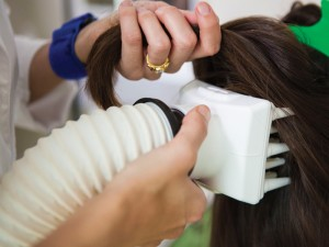 performing head lice treatment at California's Lice Clinic